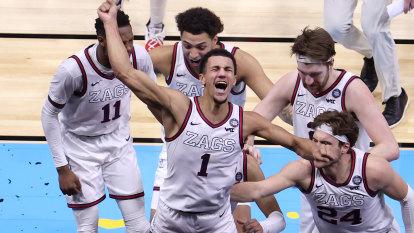 To the bank! Freshman's amazing buzzer-beater sets NCAA tournament alight