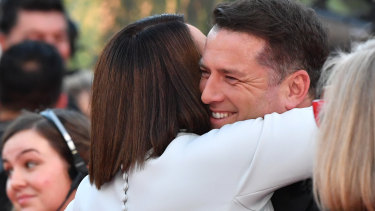 Old mate: Julia Morris hugs Karl Stefanovic on this year's Logie's red carpet.