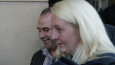 Nicola Gobbo with Tony Mokbel outside court in 2004.