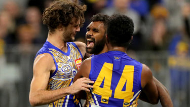 Liam Ryan celebrates after kicking a goal  against the Demons at Optus Stadium.