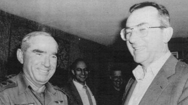 Rafi Eitan, then Israel's chief of staff, greets its defence minister Moshe Arens, in 1982.