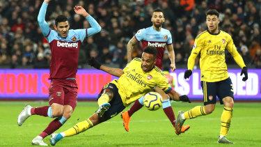 Pierre-Emerick Aubameyang scores Arsenal's third goal at London Stadium.