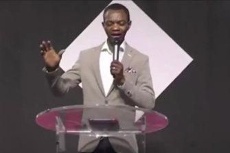 Christ Embassy Sydney Pastor Marvin Osaghae, leading a prayer on a livestream posted to social media earlier on Sunday.