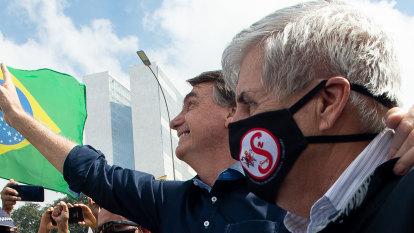 'Legend' Bolsonaro hails supporters as crises grow