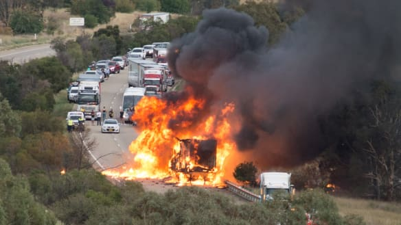 Truck carrying aerosol cans catches fire on Hume Highway