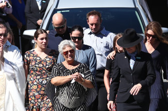 Tommy Raudonikis' wife Trish Brown leads the procession during the funeral for the rugby league great at Sacred Heart Catholic Church on the Gold Coast on Friday.