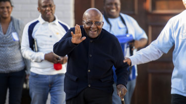 Anglican Archbishop Desmond Tutu exits his home after casting his special vote near Cape Town, South Africa.