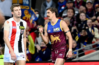 Joe Daniher celebrates after kicking a goal for the Lions.