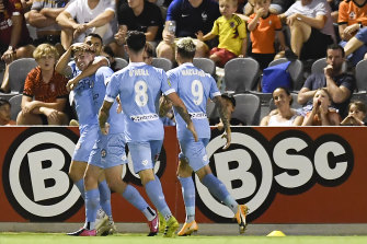 Metcalfe is mobbed by his Melbourne City teammates.
