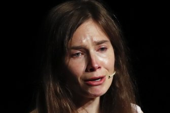 Amanda Knox gets emotional as she speaks at a Criminal Justice Festival at the University of Modena, Italy.