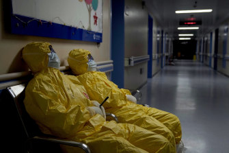 Exhausted frontline health workers take a breather in a hospital corridor in Wuhan in a scene from the documentary 76 Days.