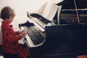 Molly Lewis as a child – while she hails from a musical home, she is the only family member who whistles.