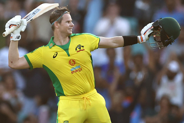 Steve Smith raises his bat after making a century.