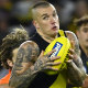 Dustin Martin tries to escape the attentions of Callan Ward.