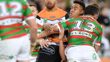 All is forgiven: Burgess collects Tigers hooker Robbie Farah across the face.
