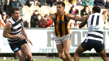 Cutting a swathe: Hawk Jaeger O'Meara breaks past Tim Kelly (right) and Patrick Dangerfield of the Cats.