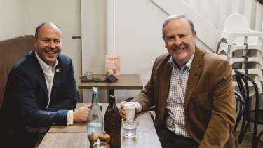 Josh Frydenberg (left) has enlisted Peter Costello, who ran surpluses for a decade, to take part in several promotional photo shoots at Melbourne coffee shops since becoming Treasurer.