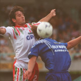 Olympic's Glen Johnson (obscured) tries to control the ball in front of a Morwell Falcons opponent in 1995.