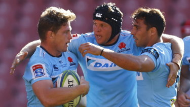 Digging in: the Waratahs celebrate captain Michael Hooper's try in South Africa.