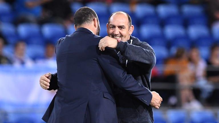 Mates: Argentina coach Mario Ledesma hugs Wallabies boss Michael Cheika.