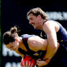 Eric Hipwood (L) and Joe Daniher (R) wrestle for the ball at Brisbane training on Wednesday.