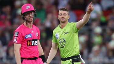 Daniel Sams celebrates his dismissal of Sixers batsman Jordan Silk.