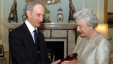 Queen Elizabeth II awards Lord May of Oxford the Insignia of a Member of the Order of Merit, 2002.