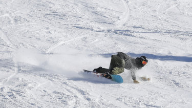 Kai Rennie, 13, getting low as he carves at Perisher.