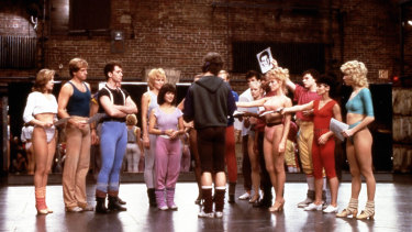 A scene from the 1985 film A Chorus Line, as the dancers hand over their headshots after being picked to go through to the next round of auditions.