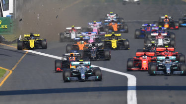 Forced wide: Daniel Ricciardo raises a cloud of detritus and dust on the far left of the pack after impact with turn one obstacle.