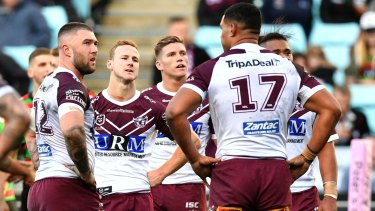 Daly Cherry-Evans (centre) in anguish following a second last-gasp loss at ANZ Stadium in three days.