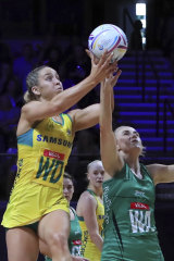 Jamie-Lee Price and Northern Ireland skipper Caroline O'Hanlon do battle for the ball at the World Cup.
