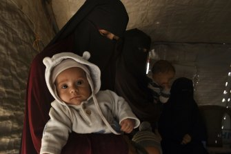 Kirsty Rosse-Emile, 25, holding her two-month-old son Yahya, the youngest Australian baby in al-Hawl camp in Syria in October.