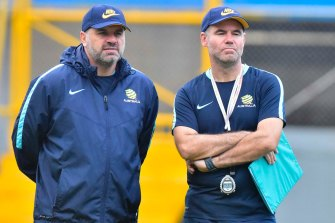 Ange Postecoglou and Ante Milicic watch the Socceroos train in Honduras in 2017.