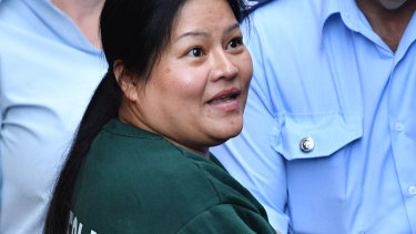 Dung Thi Ngo is escorted from court on Monday.
