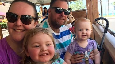 Cath Fowler, with husband Scott and daughters Lily, 3, and Layla, 1, wants to retire at about 45.