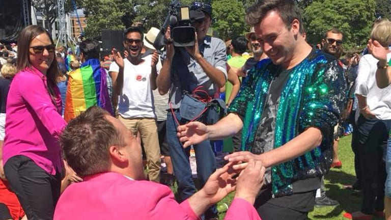 James 'Breko' Brechney proposes to his partner Stuart Henshall after the SSM postal survey result announcement in Sydney's Prince Alfred Park.