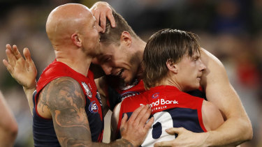 Nathan Jones celebrates a goal with Tom McDonald and Charlie Spargo earlier this season.