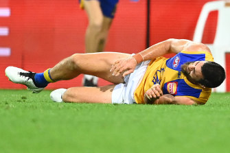 Eagles spearhead Josh Kennedy goes down against the Kangaroos.