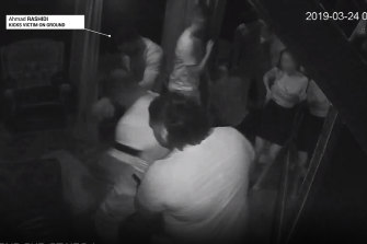 Ahmad Rashidi, a younger brother of Finks bikie gang leader Kosh Radford, is seen kicking a man in a screenshot from a video of the incident that took place at a Melbourne strip club in March 2019.
