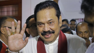 Newly appointed Sri Lankan Prime Minister Mahinda Rajapaksa leaves a Buddhist temple after meeting his supporters in Colombo.