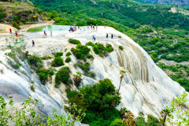 Landscape of Hierve el Agua, Oaxaca, Mexico. Panoramic view of the mountains from the hot springs of Hierve El Agua. xxMexico Hierve el Agua petrified falls Oaxaca Mexico ; text by Alison Stewart ; iStock *** reuse permitted ***