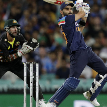 Earl Eddings says one day we will wonder how we managed to get India to Australia for a full series. Pictured is Indian captain Virat Kohli and Australian counterpart Matt Wade in the T20 this week at the SCG.