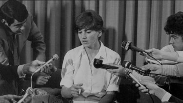 """""""Kate Webb faces the microphones at Kingsford Smith Airport yesterday."""" May 12, 1971."""
