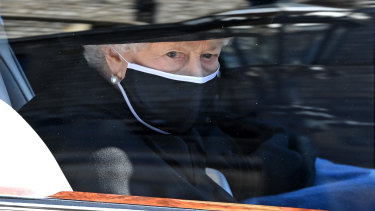 The Queen arrives for the funeral in the state Bentley.