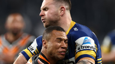 Moses Mbye is tackled by Nathan Brown.