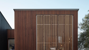 The double-fronted timber home was set within a heritage-listed streetscape.