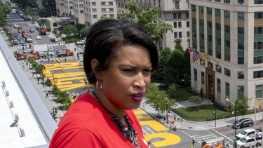 District of Columbia mayor Muriel Bowser stands on the rooftop of the Hay Adams Hotel near the White House and looks out at the words 'Black Lives Matter' that have been painted in bright yellow letters on the street.