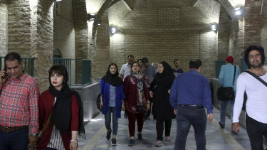 People walk at the old main bazaar in Tehran, Iran.