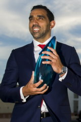 Adam Goodes accepts his Australian of the Year award in 2014.